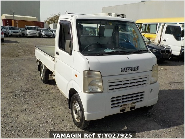 It is a picture of the white suzuki carry truck in 2002,Sub Photo 0 Stock No.Y027925