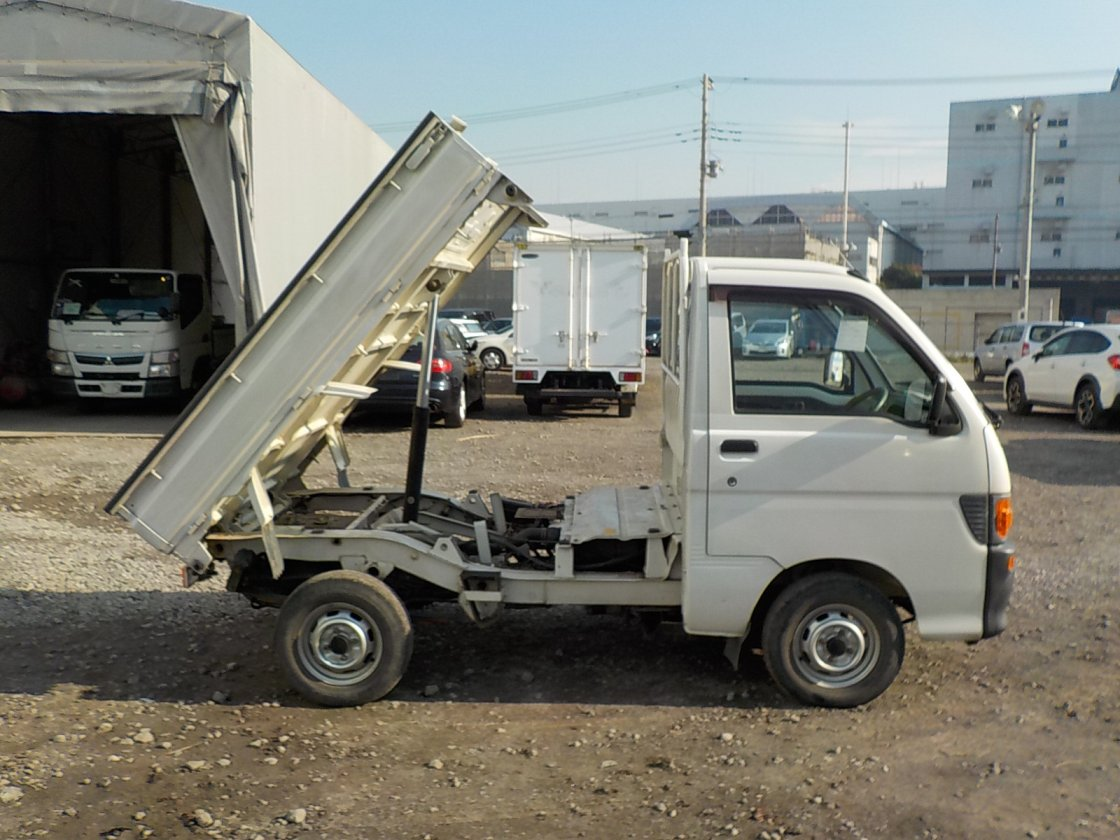 It is a picture of the white daihatsu hijet dump in 1997,First Photo Stock No.Y028693