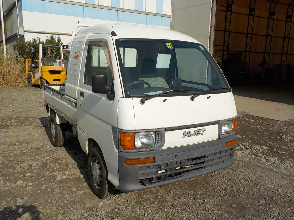 It is a picture of the white daihatsu hijet  jumbo in 1997,First Photo Stock No.Y028759