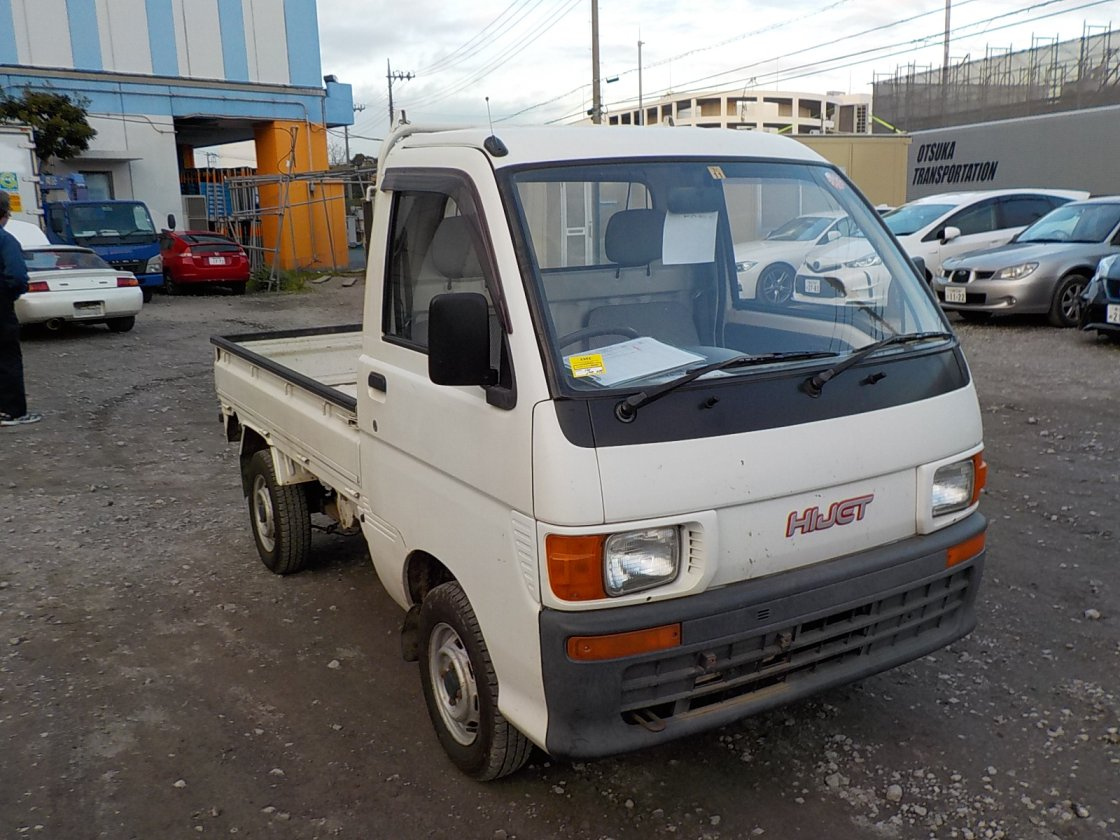 It is a picture of the white daihatsu hijet truck in 1995,First Photo Stock No.Y028823