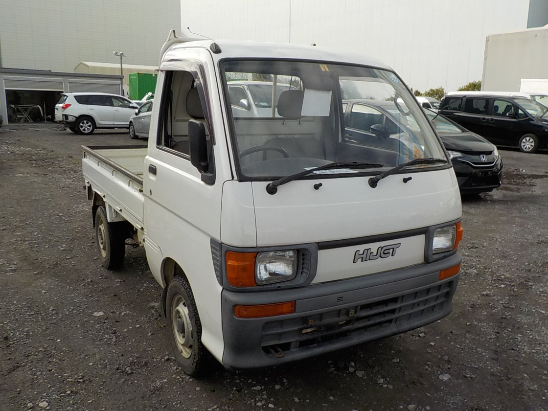 It is a picture of the white daihatsu hijet truck in 1995,First Photo Stock No.Y028908