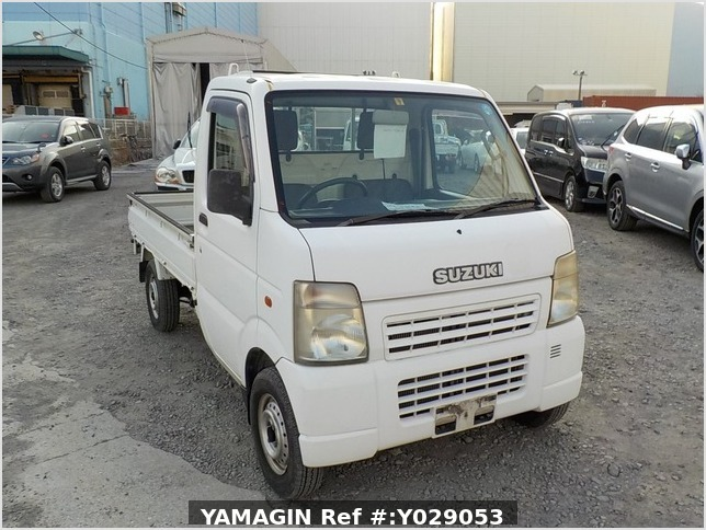 It is a picture of the white suzuki carry truck in 2002,Sub Photo 0 Stock No.Y029053