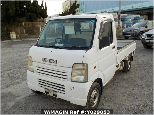 It is a picture of the white suzuki carry truck in 2002,Sub Photo 1 Stock No.Y029053
