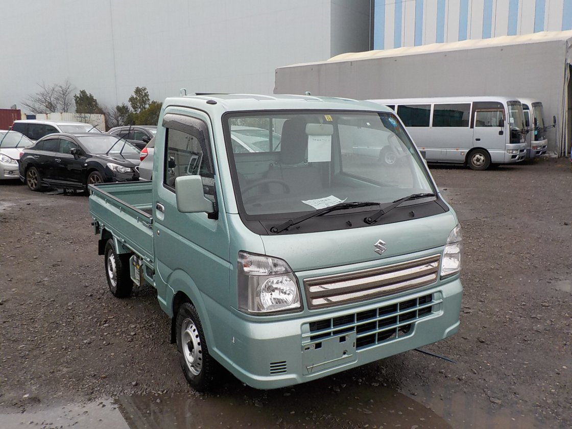 It is a picture of the green suzuki carry truck in 2016,First Photo Stock No.Y029058