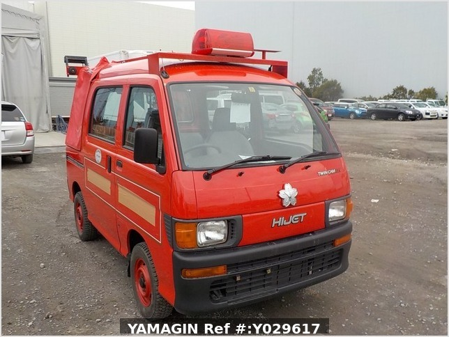 It is a picture of the red daihatsu hijet deck van in 1998,Sub Photo 0 Stock No.Y029617