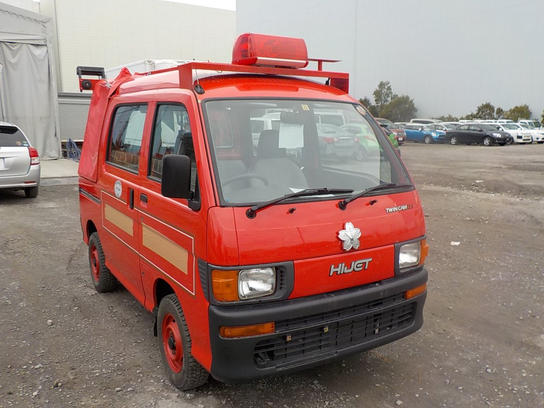 It is a picture of the red daihatsu hijet deck van in 1998,First Photo Stock No.Y029617