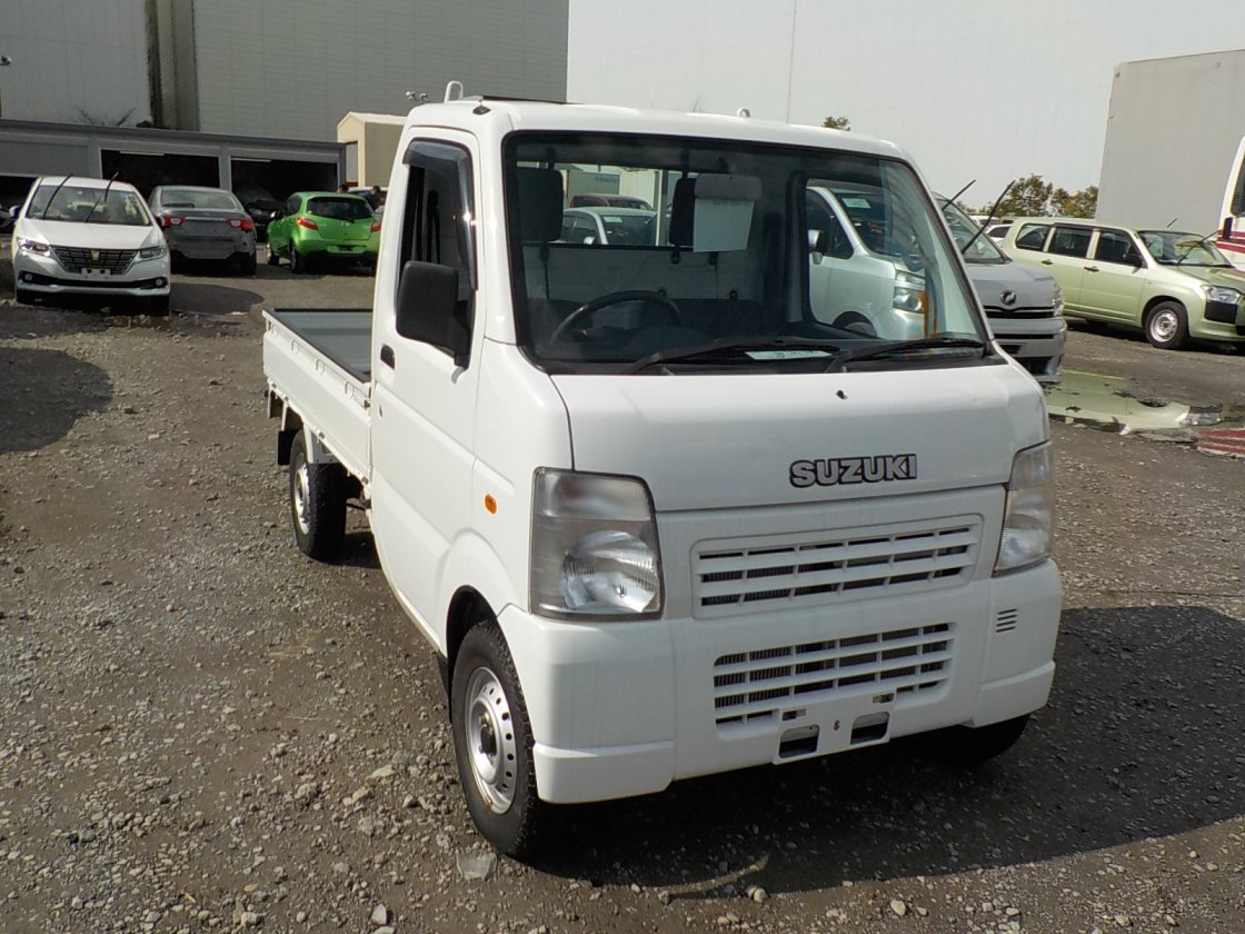 It is a picture of the white suzuki carry truck in 2009,First Photo Stock No.Y029635