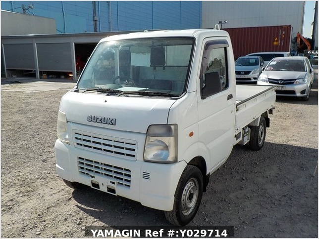 It is a picture of the white suzuki carry truck in 2004,Sub Photo 1 Stock No.Y029714