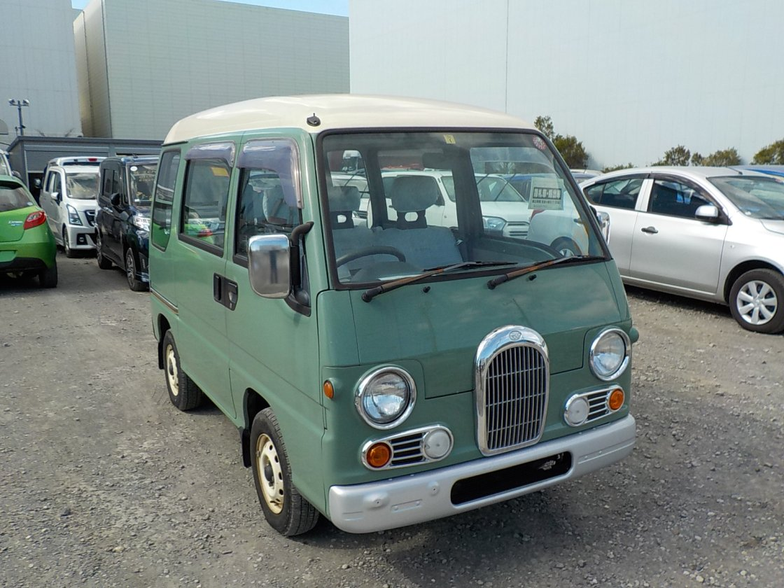 It is a picture of the green 2 subaru sambar dias passenger van in 1995,First Photo Stock No.Y029905
