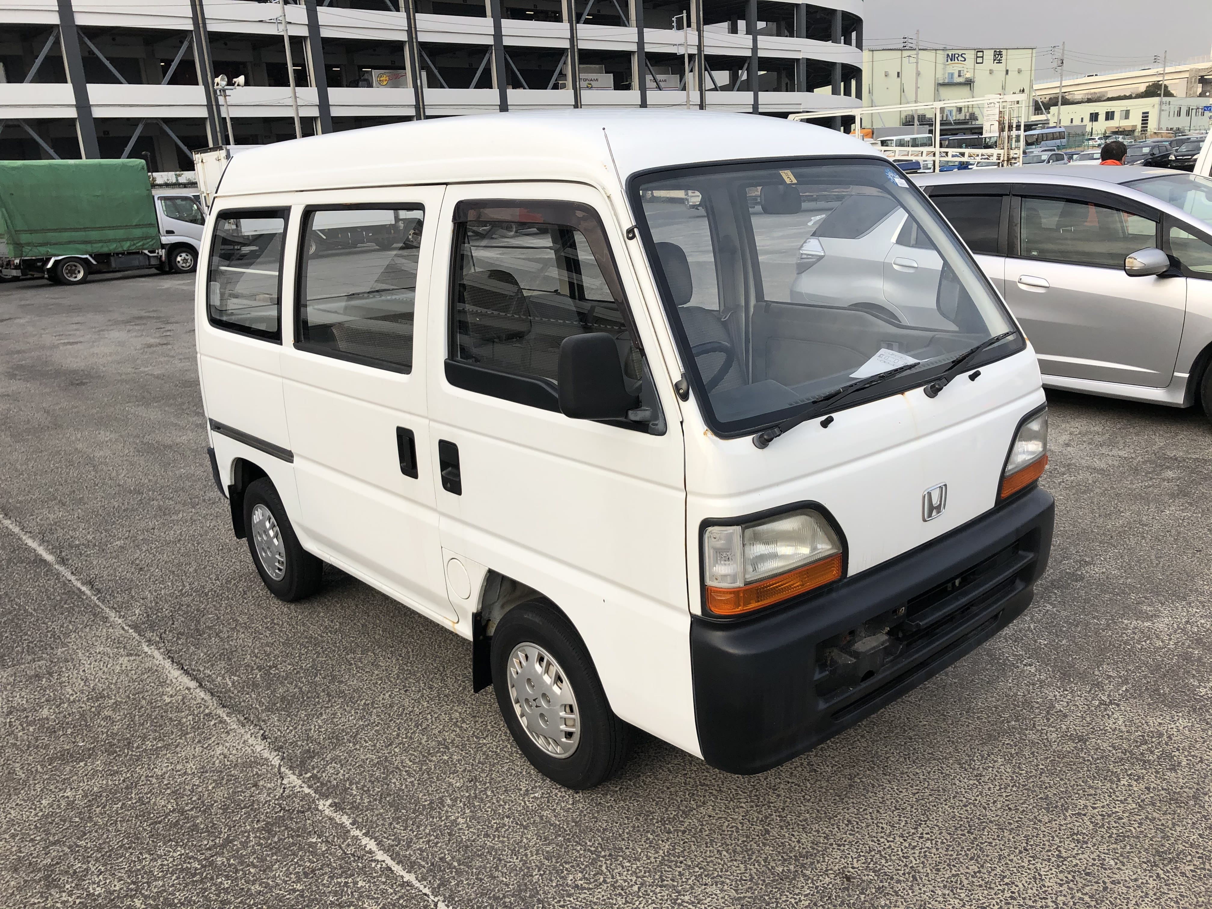 It is a picture of the white honda acty van passenger van in 1995,First Photo Stock No.Y029975