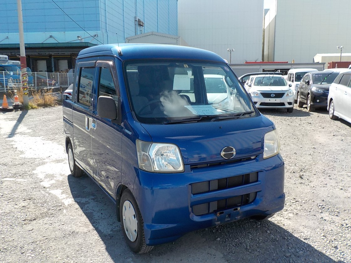 It is a picture of the blue daihatsu hijet deck van in 2007,First Photo Stock No.Y030017
