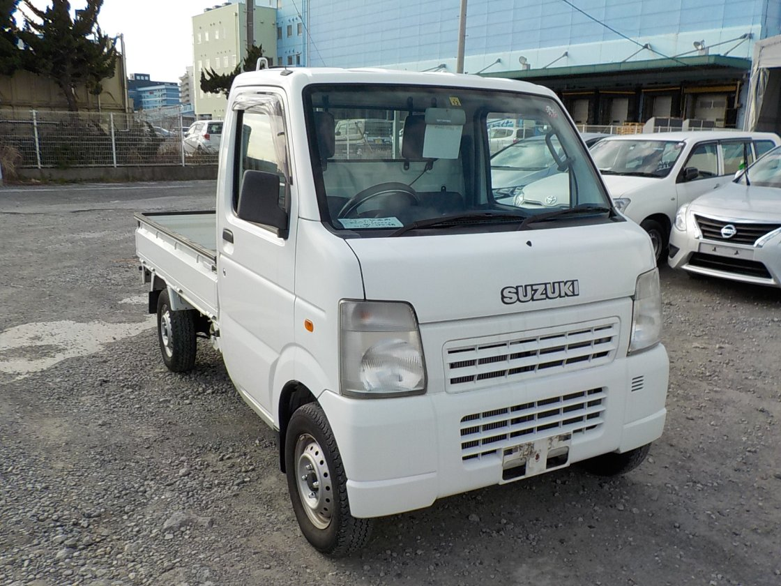 It is a picture of the white suzuki carry truck in 2008,First Photo Stock No.Y030084
