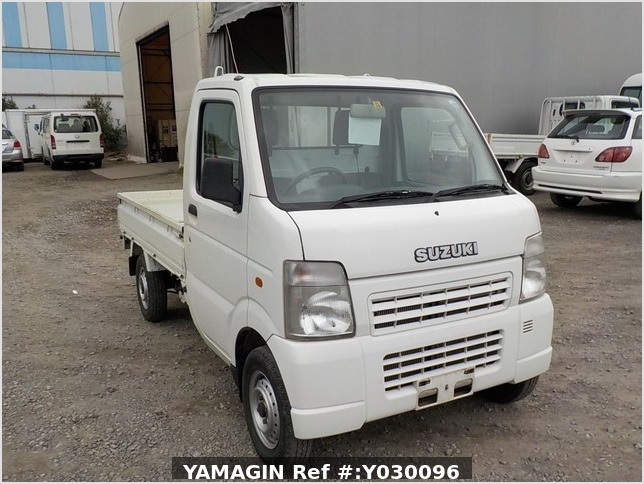 It is a picture of the white suzuki carry truck in 2004,Sub Photo 0 Stock No.Y030096