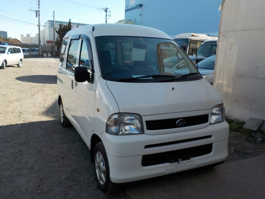 It is a picture of the white daihatsu hijet passenger van in 2001,First Photo Stock No.Y030098