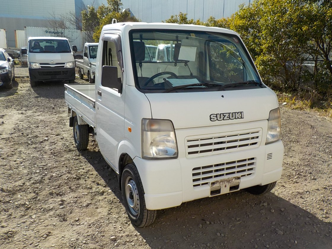 It is a picture of the white suzuki carry truck in 2007,First Photo Stock No.Y030099