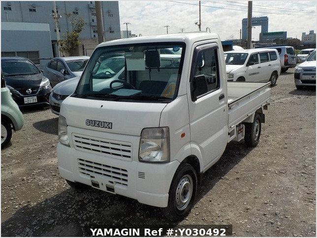 It is a picture of the white suzuki carry truck in 2004,Sub Photo 1 Stock No.Y030492
