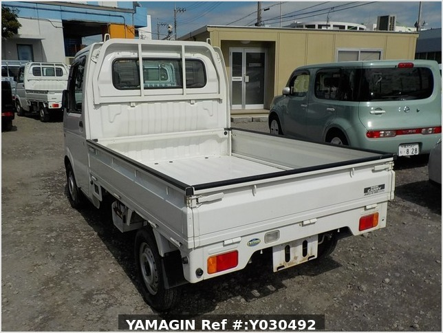 It is a picture of the white suzuki carry truck in 2004,Sub Photo 3 Stock No.Y030492