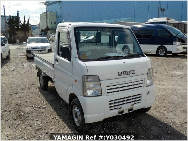 It is a picture of the white suzuki carry truck in 2004,Sub Photo 0 Stock No.Y030492