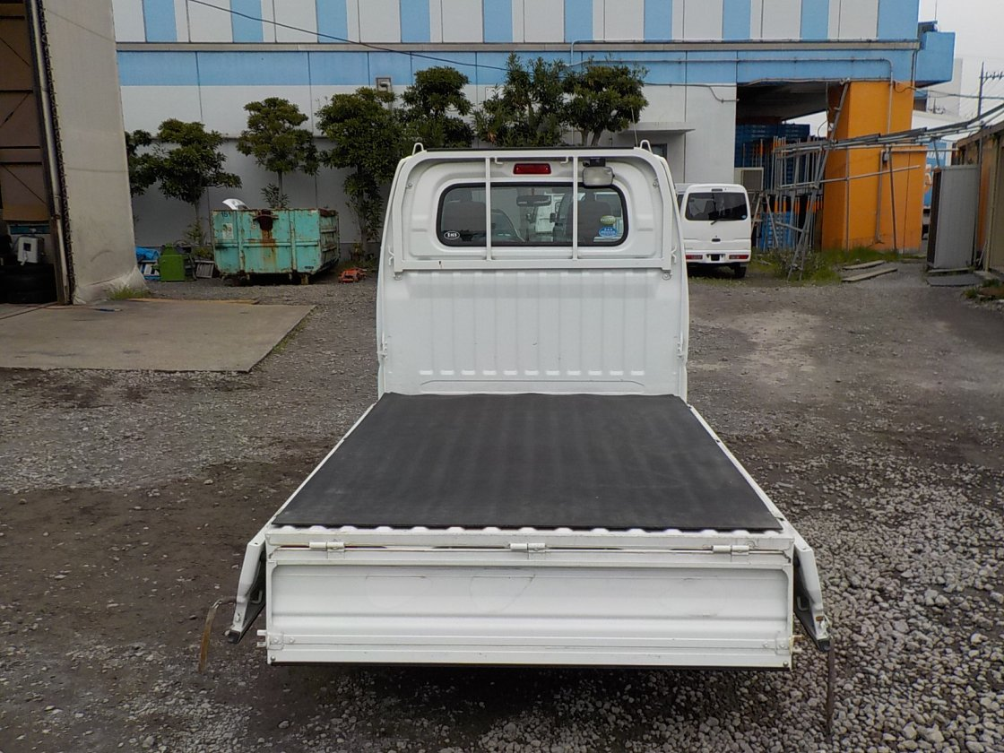 It is a picture of the white mitsubishi minicab truck in 2010,First Photo Stock No.Y030687
