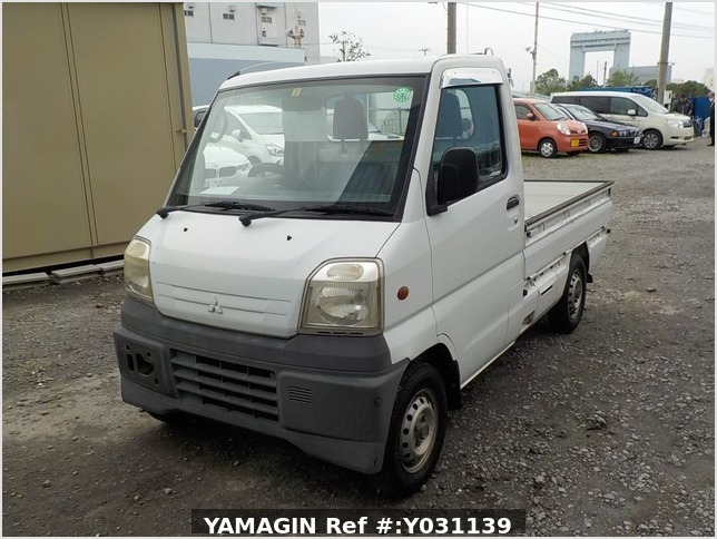 It is a picture of the white mitsubishi minicab truck in 1999,Sub Photo 1 Stock No.Y031139