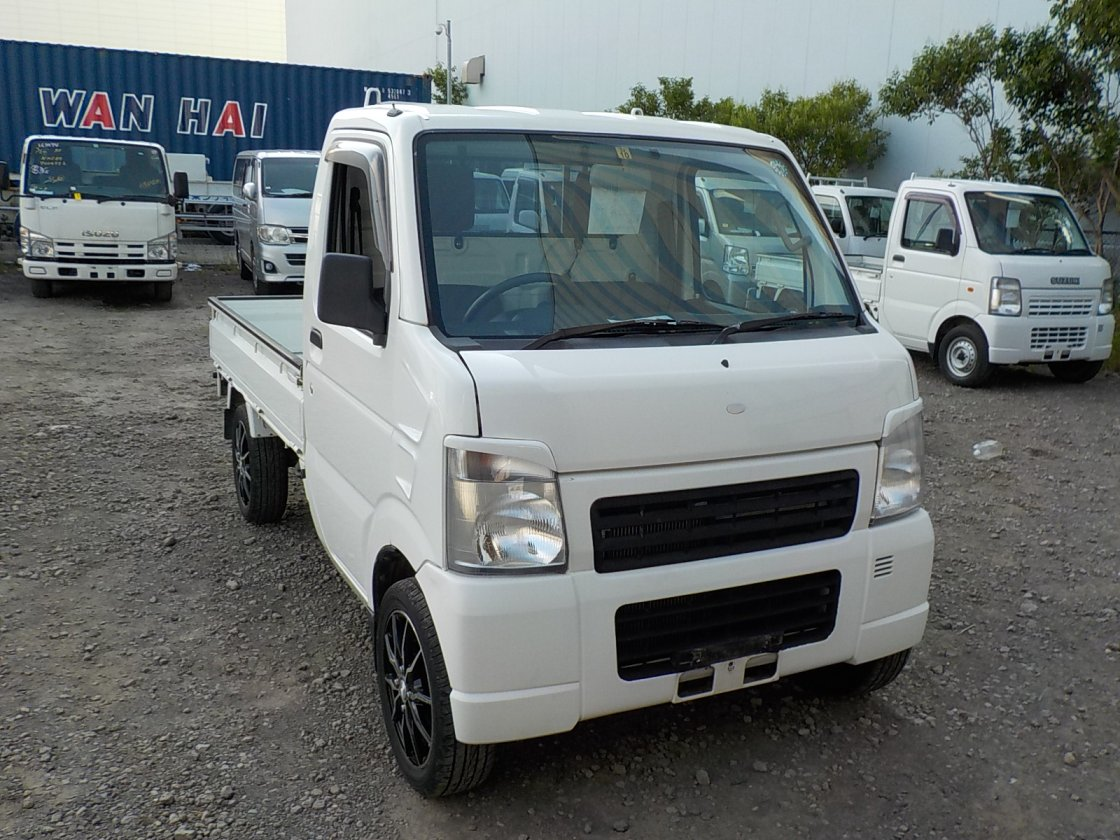 It is a picture of the white suzuki carry truck in 2008,First Photo Stock No.Y031184