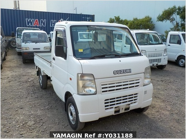 It is a picture of the white suzuki carry truck in 2004,Sub Photo 0 Stock No.Y031188