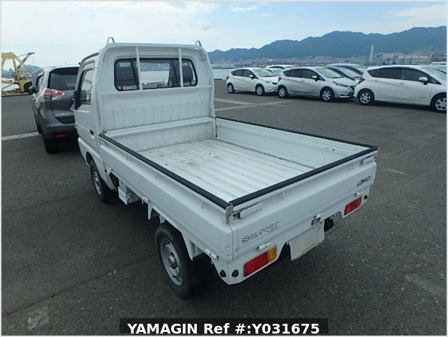 It is a picture of the white suzuki carry truck in 1993,Sub Photo 2 Stock No.Y031675