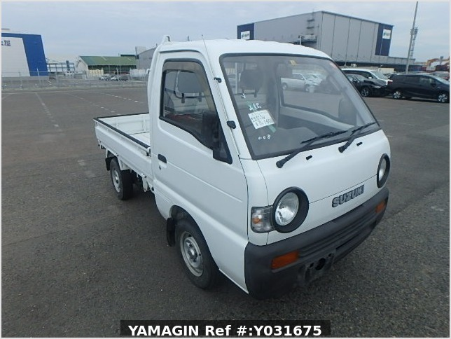 It is a picture of the white suzuki carry truck in 1993,Sub Photo 0 Stock No.Y031675