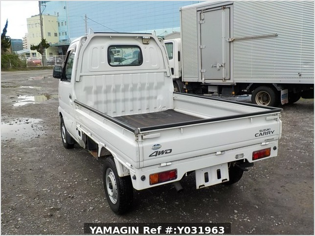 It is a picture of the white suzuki carry truck in 2002,Sub Photo 3 Stock No.Y031963