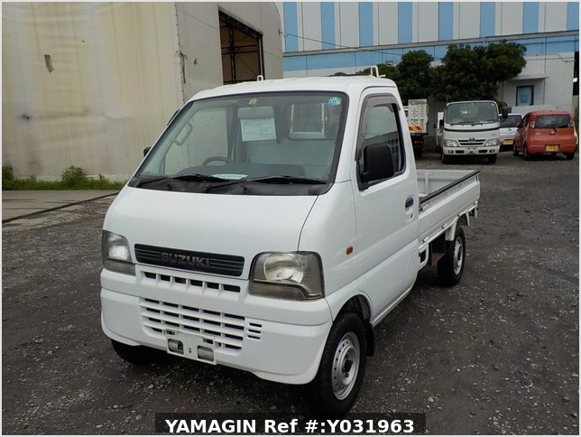 It is a picture of the white suzuki carry truck in 2002,Sub Photo 1 Stock No.Y031963
