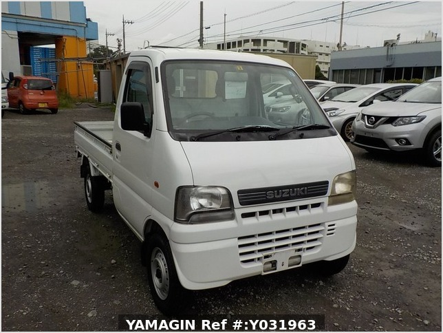 It is a picture of the white suzuki carry truck in 2002,Sub Photo 0 Stock No.Y031963