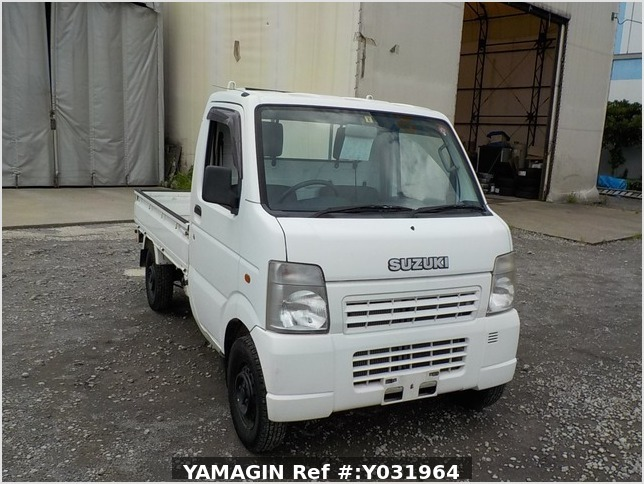 It is a picture of the white suzuki carry truck in 2004,Sub Photo 0 Stock No.Y031964