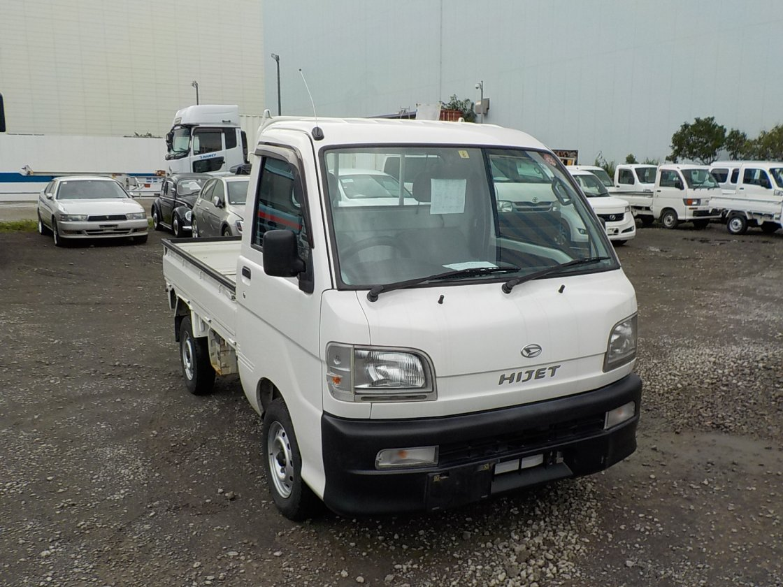 It is a picture of the white daihatsu hijet truck in 1999,First Photo Stock No.Y032065