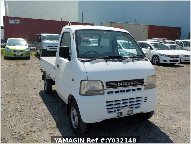 It is a picture of the white suzuki carry truck in 2002,Sub Photo 0 Stock No.Y032148