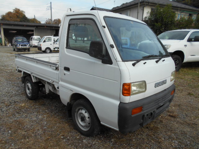 It is a picture of the white suzuki carry truck in 1996,First Photo Stock No.Y032329