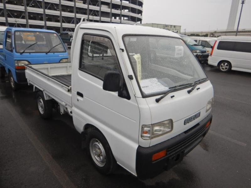 It is a picture of the white suzuki carry truck in 1994,First Photo Stock No.Y032364