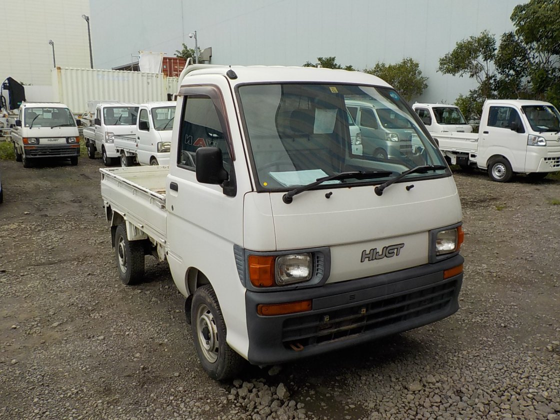 It is a picture of the white daihatsu hijet truck in 1998,First Photo Stock No.Y032446