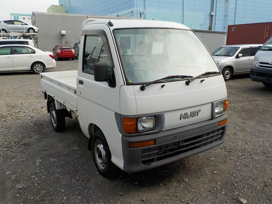It is a picture of the white daihatsu hijet truck in 1998,First Photo Stock No.Y032463