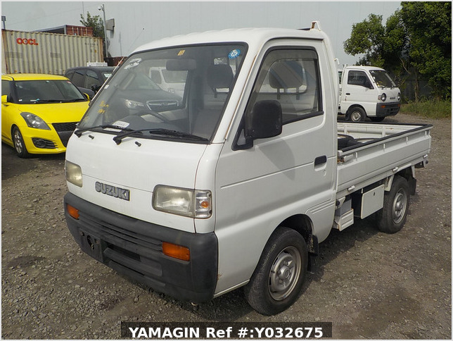 It is a picture of the white suzuki carry truck in 1992,Sub Photo 0 Stock No.Y032675