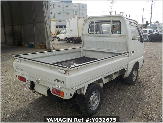 It is a picture of the white suzuki carry truck in 1992,Sub Photo 23 Stock No.Y032675