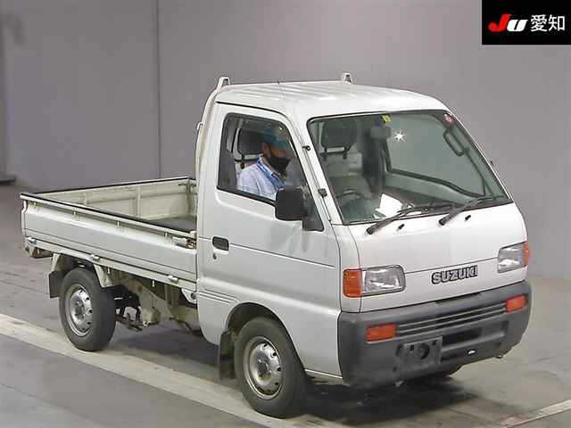 It is a picture of the white suzuki carry truck in 1995,First Photo Stock No.Y032722