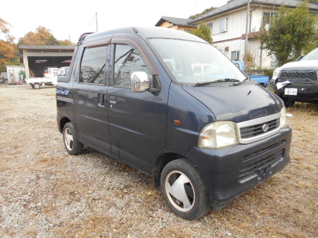 It is a picture of the blue daihatsu hijet deck van in 2001,First Photo Stock No.Y032861