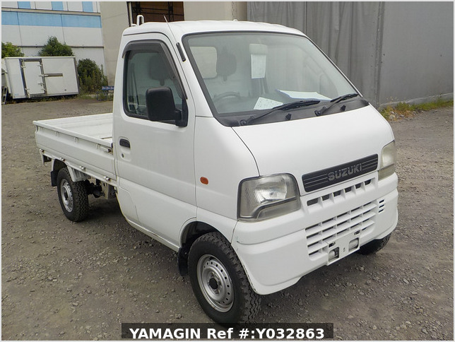It is a picture of the white suzuki carry truck in 2002,Sub Photo 0 Stock No.Y032863