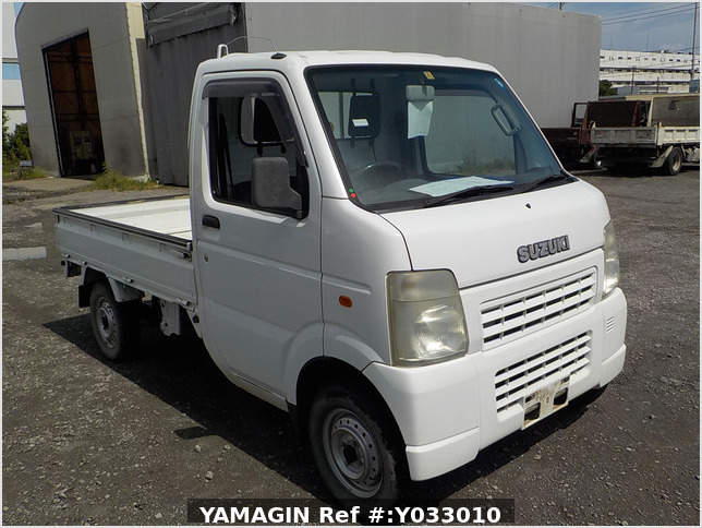 It is a picture of the white suzuki carry truck in 2002,Sub Photo 0 Stock No.Y033010