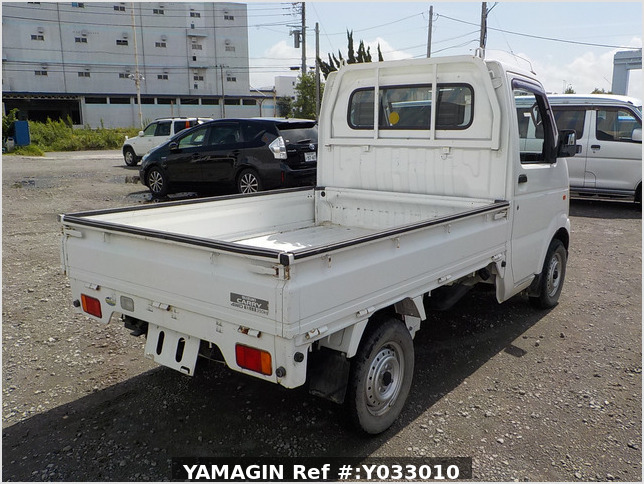 It is a picture of the white suzuki carry truck in 2002,Sub Photo 2 Stock No.Y033010