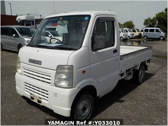 It is a picture of the white suzuki carry truck in 2002,Sub Photo 1 Stock No.Y033010