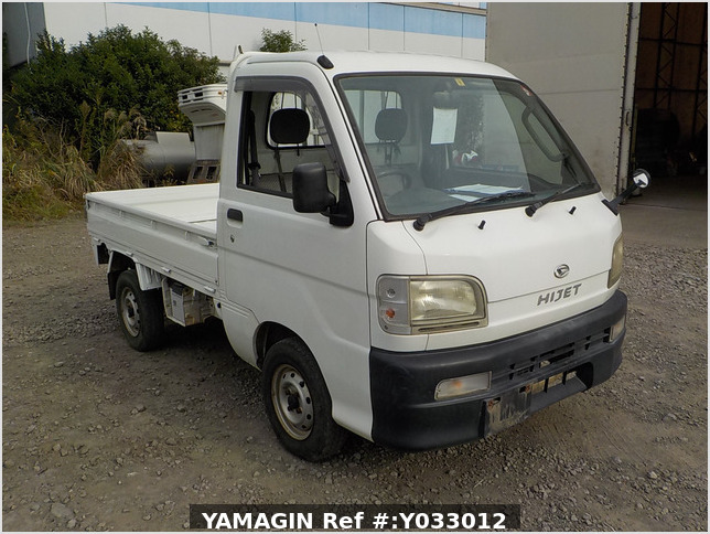 It is a picture of the white daihatsu hijet truck in 1999,Sub Photo 0 Stock No.Y033012