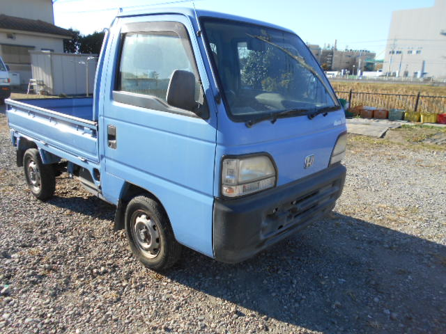 It is a picture of the blue honda acty truck in 1996,First Photo Stock No.Y033307