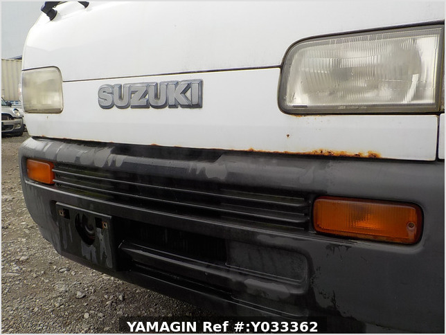 It is a picture of the white suzuki carry truck in 1993,Sub Photo 14 Stock No.Y033362