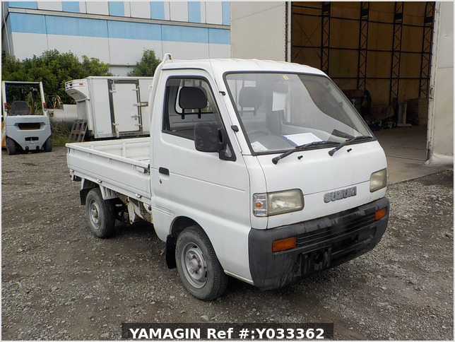 It is a picture of the white suzuki carry truck in 1993,Sub Photo 0 Stock No.Y033362